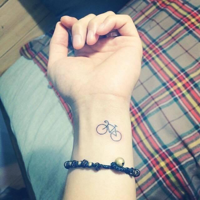 bicycle tattoo on wrist